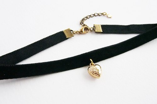 Black velvet choker / necklace with gold heart charm.