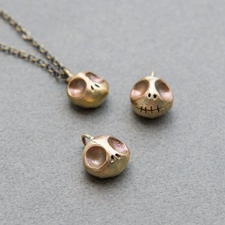 Take a look at my dead face brass / skull head / necklace