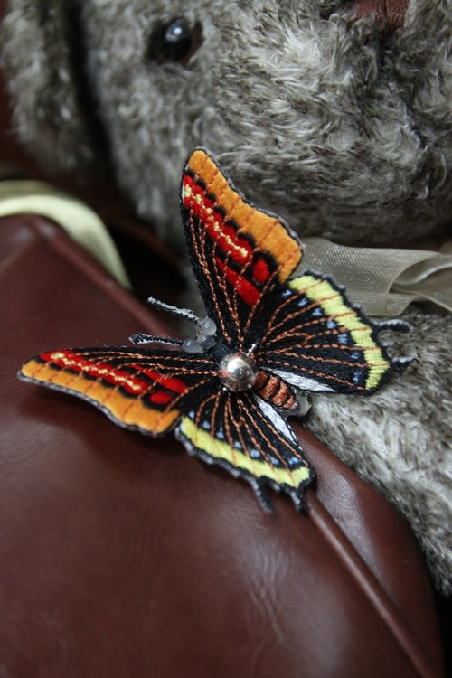 And the wind cloth butterfly pin - yellow and red