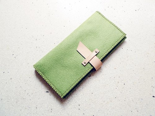 Olive green fabric decorated with leather long cloth clip