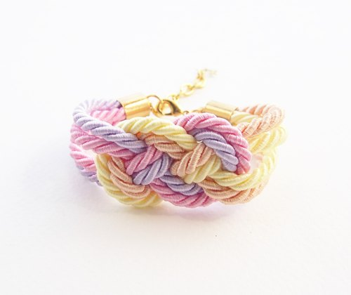 Light yellow / light pink / peach / lilac nautical rope bracelet.