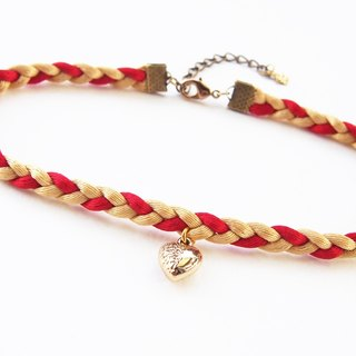 Red gold braided choker/necklace with tiny gold heart charm