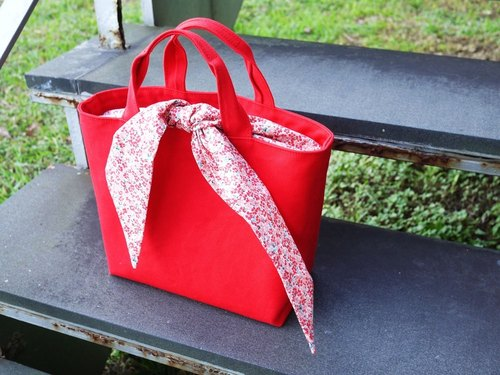 Towel tied to drag special package - red floral section