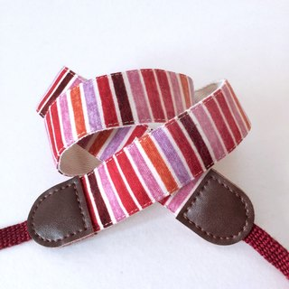 Red and red stripe camera strap