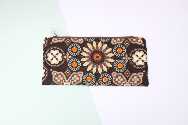 Pencil case with brown Vera Bradley print.