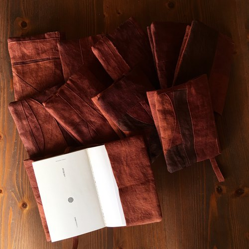 """Persimmon juice linen book cover"""