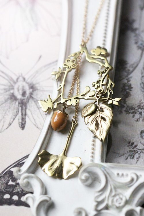 Necklace, pendant vines and nuts.