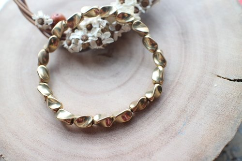 Fuchia ~ ~ silently twisted brass bead bracelet