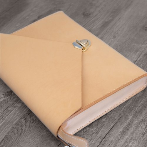 Hand holding vegetable tanned leather package