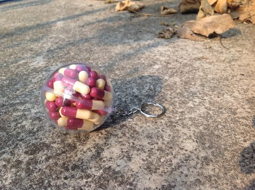 Ball rescue Series key ring - with wine, apple muscle