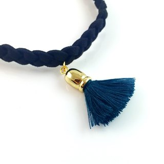 """Black twist necklace - blue tassel."""