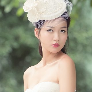 Millinery Round sinamay hat with veiling bridal hat headpiece