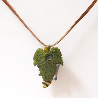 Raccoon and leaf handmade necklace