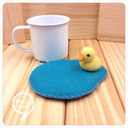 Yellow Duck playing in the water play. Hand coasters