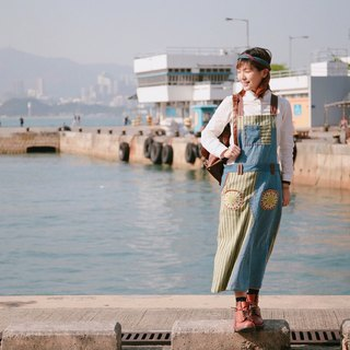 Striped denim patchworker skirt on the coast and green grass
