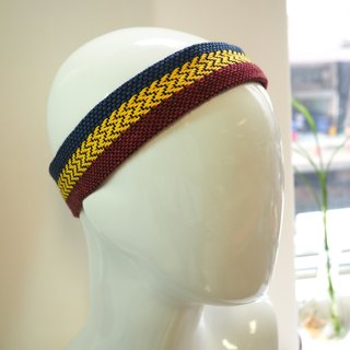 Hand-woven and colored head with blue and yellow