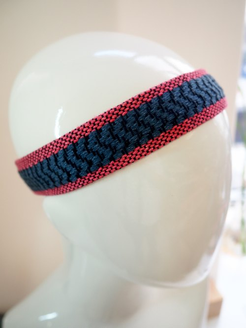 Woven and shaved head with red and blue