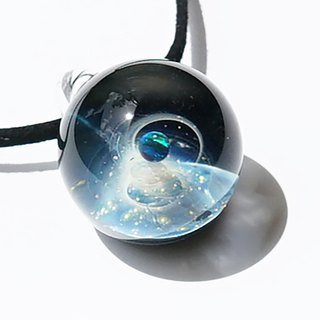 The first star shining in the night sky. Glass pendant with green opal Space universe