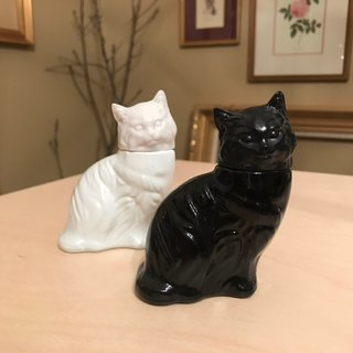 Cologne bottle black and white cat pair