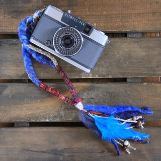 Feather decoration · wood beaded hemp and knit handstrap blue