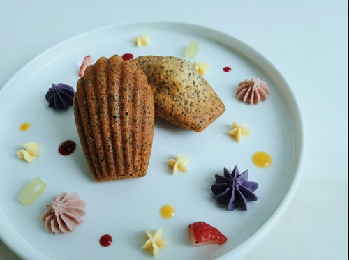Three-quarters of French desserts Madeleine Madeleine} {
