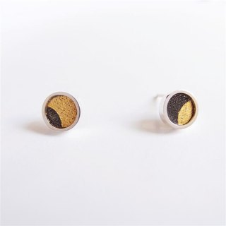 A centimeter round A-925 silver earring on the ear