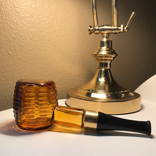 Cologne bottle tobacco pipe