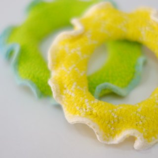 Two sets of hair ring circle a group of mint & lemon