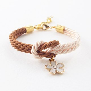 Brown and ivory cream knot rope bracelet with white flower charm