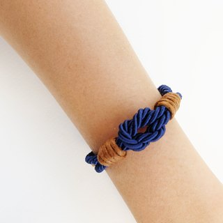 Navy blue tie the knot bracelet with brown waxed cotton cord