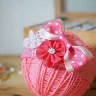 Unique handmade baby headband with ribbon bow and pink fabric flowers