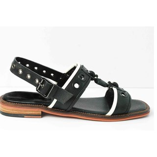 Black round hole with horizontal sandals