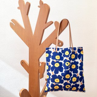 Reversible blue floral print tote bag with leather straps. Limited.