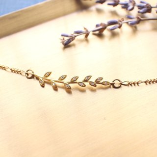 Golden leaf-zircon brass bracelet