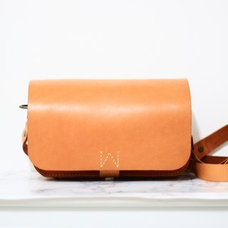 Small orange peel planted tanned leather saddle bag / side backpack
