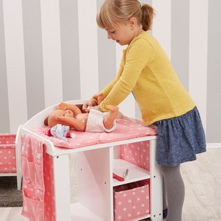Sister loves dolls. Wooden Diaper Table