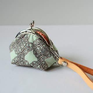A very small coin purse - knots - framed case with wristlet