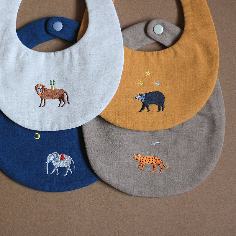 A set of cotton and linen bibs with four animals