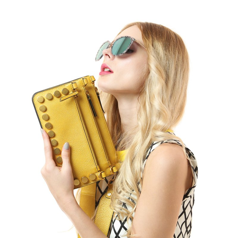 Yellow leather with golden studded three zipper diagonal bag