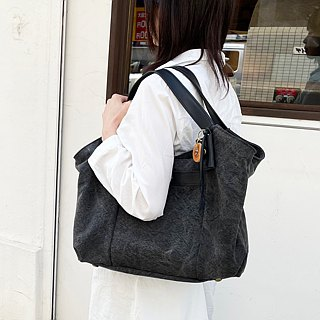 tanton - dyed cloth tanned canvas × spiked leather tote bag