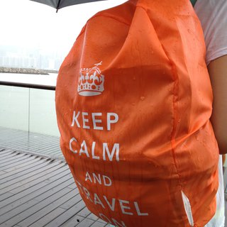 Keep Calm & Travel On Neon Backpack Cover - Orange