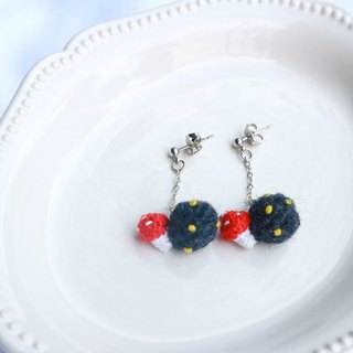Crocheted red mushroom with blue planet earrings