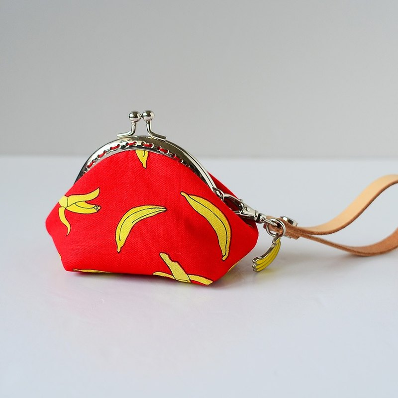 A very small coin purse - banana (red) - framed case with wristlet