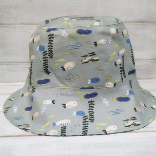 Fish swim in black checkered fisherman hat visor