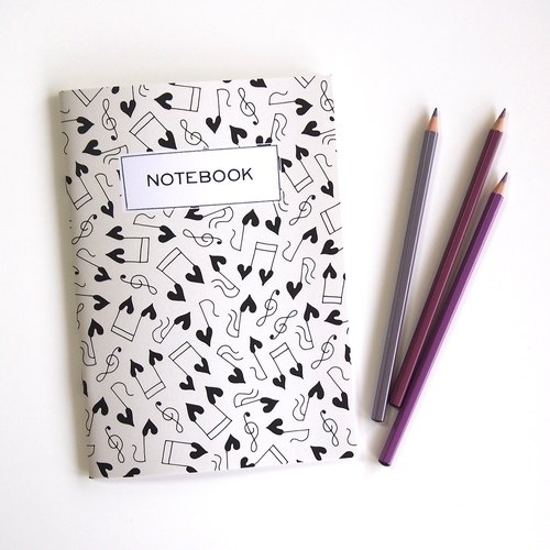 "A5 notebook ""HAPPY HEARTIC MUSICALNOTES"" blank inside"