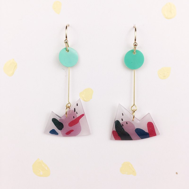 A pair of color patch reorganization series mountain earrings on the artboard