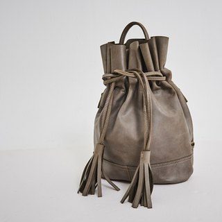Drawstring tassel hand strap backpack brown
