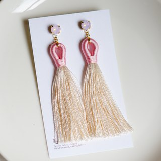 Swarovski and tassel earrings have pink