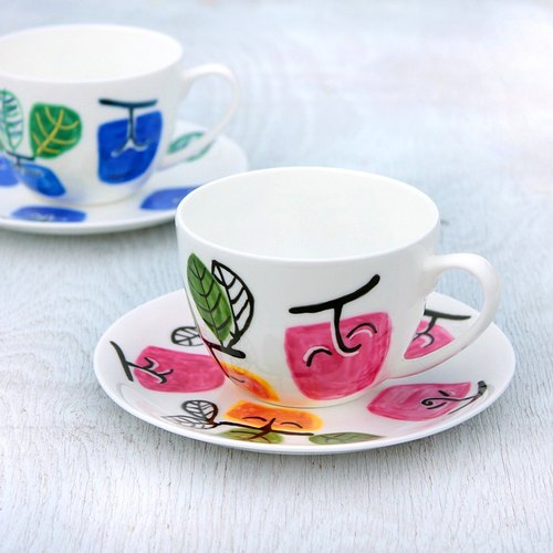 Rose pink persimmon-shaped cup and saucer