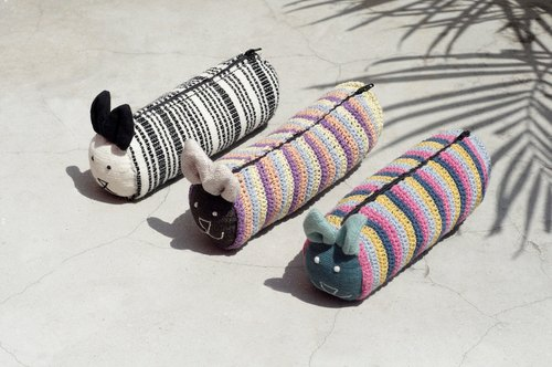 The room has a hand-woven long animal storage bag / cosmetic bag / pen case - crocheted animal bunny pencil case